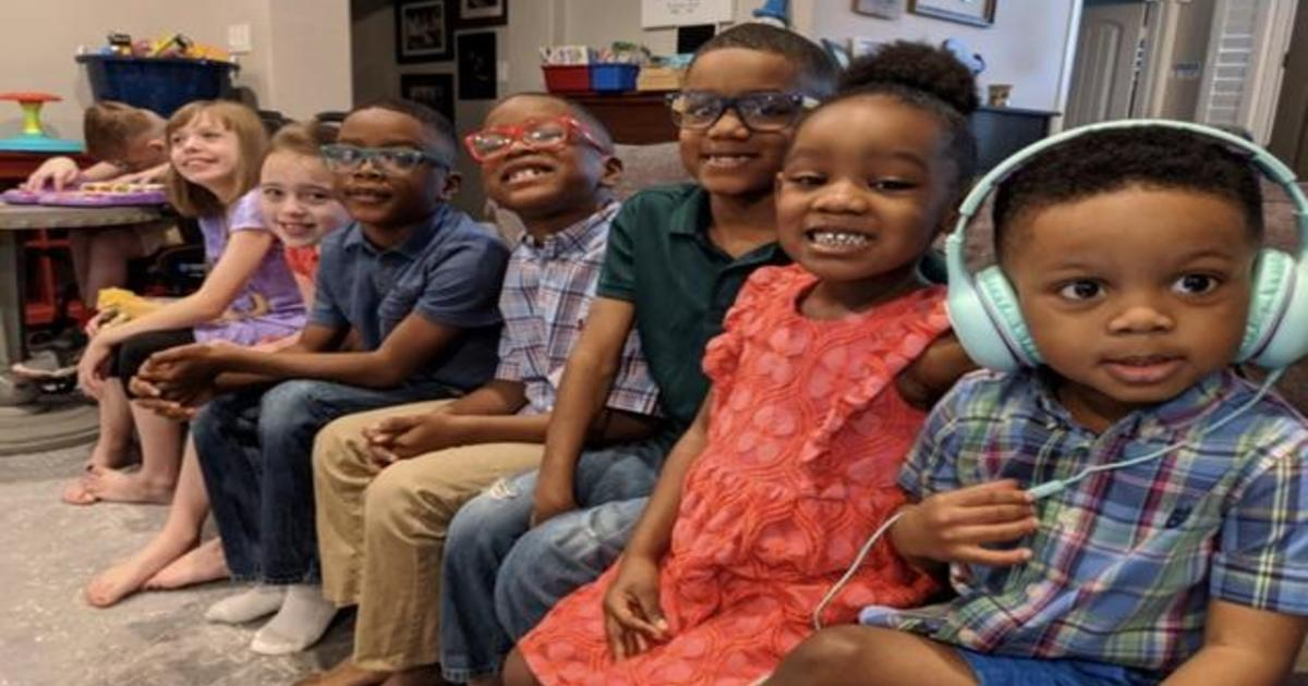 Couple adopts five siblings separated in foster care