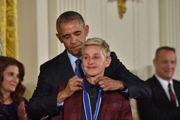 US President Barack Obama presents actress and comedian Ellen DeGeneres with the Presidential Medal of Freedom