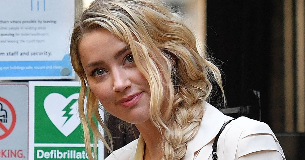 Amber Heard accused of making up Johnny Depp attack as police saw no injury