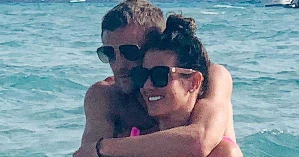 Rebekah Vardy cuddles husband Jamie in Ibiza as Coleen Rooney case looms