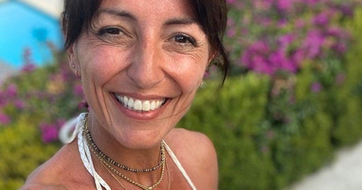 Davina McCall shows off age-defying figure in tiny white bikini