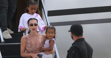 Kim Kardashian and Kanye jet into Miami after holiday 'which saved marriage'