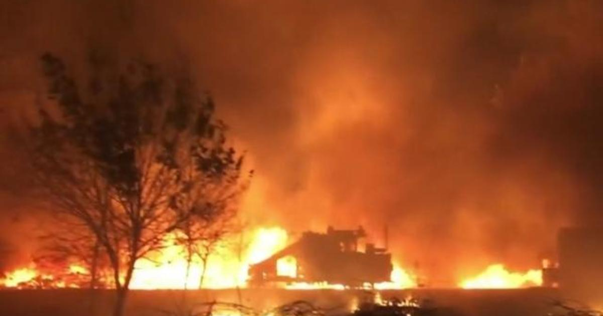 Families flee to safety as Western wildfires continue