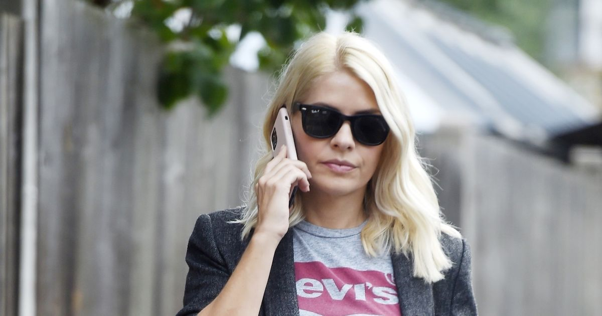 Holly Willoughby oozes class as she struts down the street in clean cut blazer