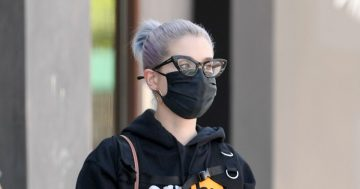 Kelly Osbourne flashes flat tum after 4-stone weight loss in porn site hoodie