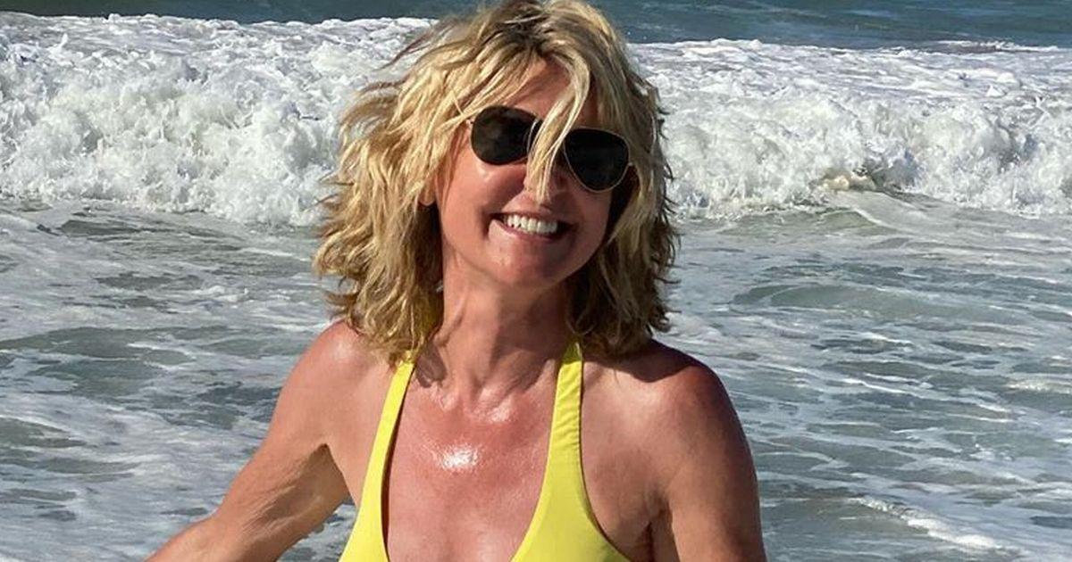 Anthea Turner, 60, looks sensational as she poses in tiny yellow bikini