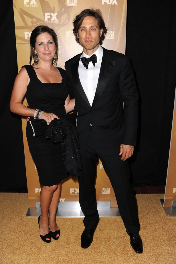 Brad pictured with first wife Suzanne in 2010