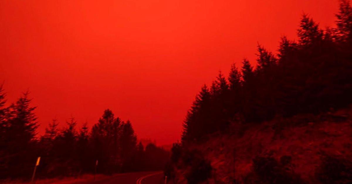 "Wildfire photos show ""apocalyptic"" red skies across Western U.S."