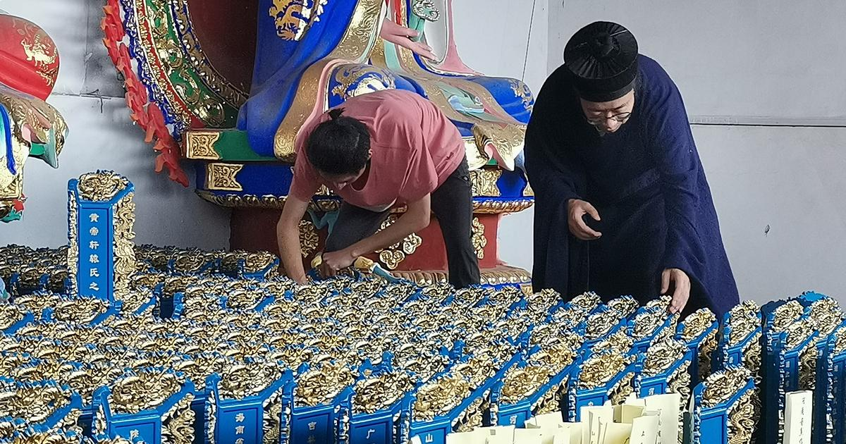 """Taoist priest's memorial tablets honor China's COVID """"heroes' spirits"""""""