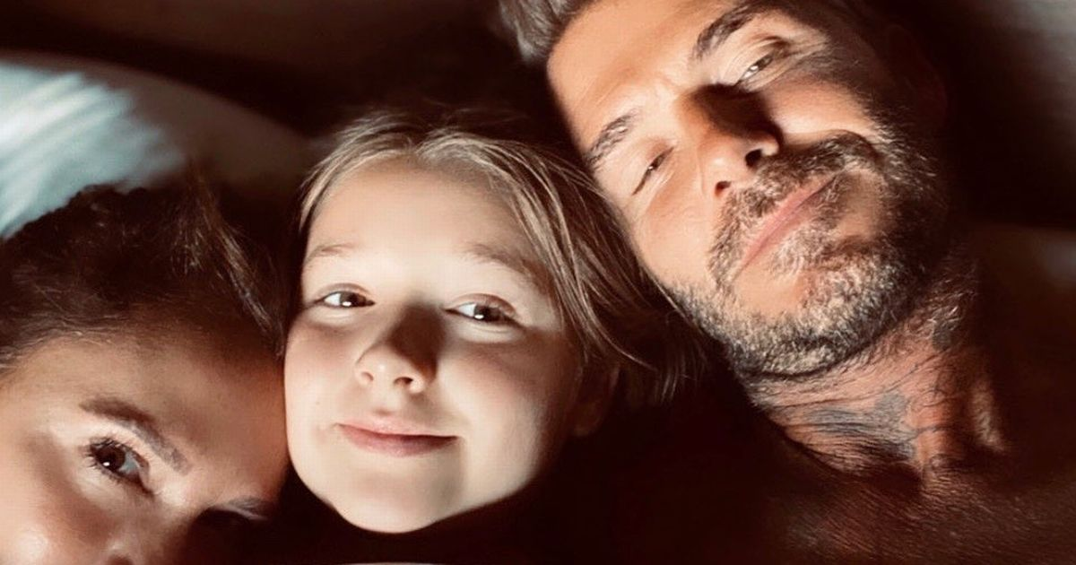 David Beckham snuggles with Victoria and Harper under covers in rare bed selfie