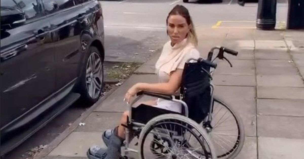 Carl Woods chucks Katie Price in wheelchair as they flaunt playful romance