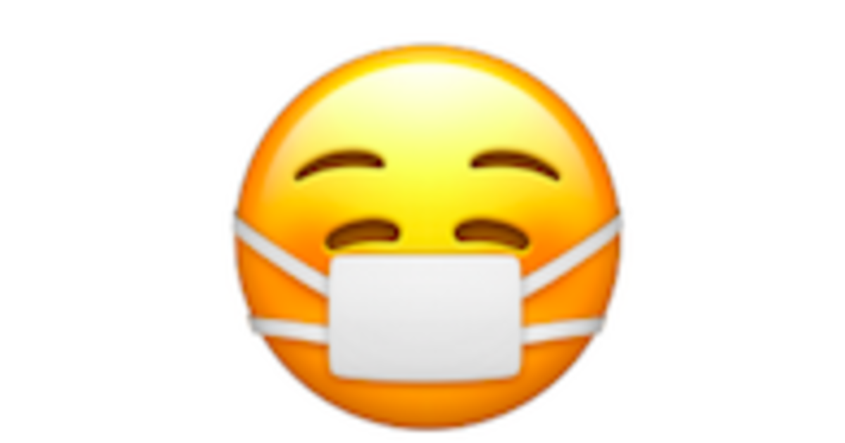 Apple's new masked emoji smiling behind face covering