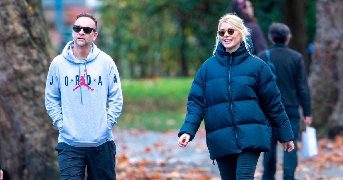 Holly Willoughby looks smitten as she holds husband Dan's hand in rare snaps