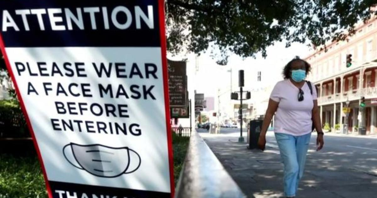 CDC issues new guidance on face masks and holiday plans as COVID cases soar
