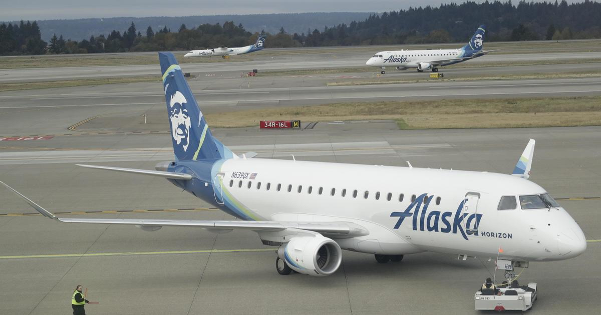 Video shows man walking on wing of plane before takeoff