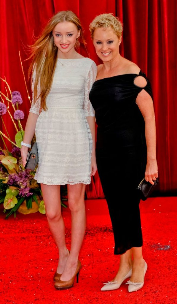 This Christmas Phoebe Dynevor, whose mother Sally stars as Corrie's Sally Webster, will star in the jewel of Netflix's festive programming, the costume drama Bridgerton; the two are seen together at the British Soap Awards in 2011
