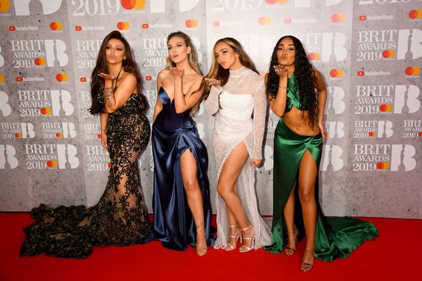 Jesy is seen with bandmates Perrie Edwards, Jade Thirlwall and Leigh-Anne Pinnock last year